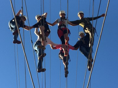 Wounded veterans work together to conquer 50-foot high ropes course at UC Irvine