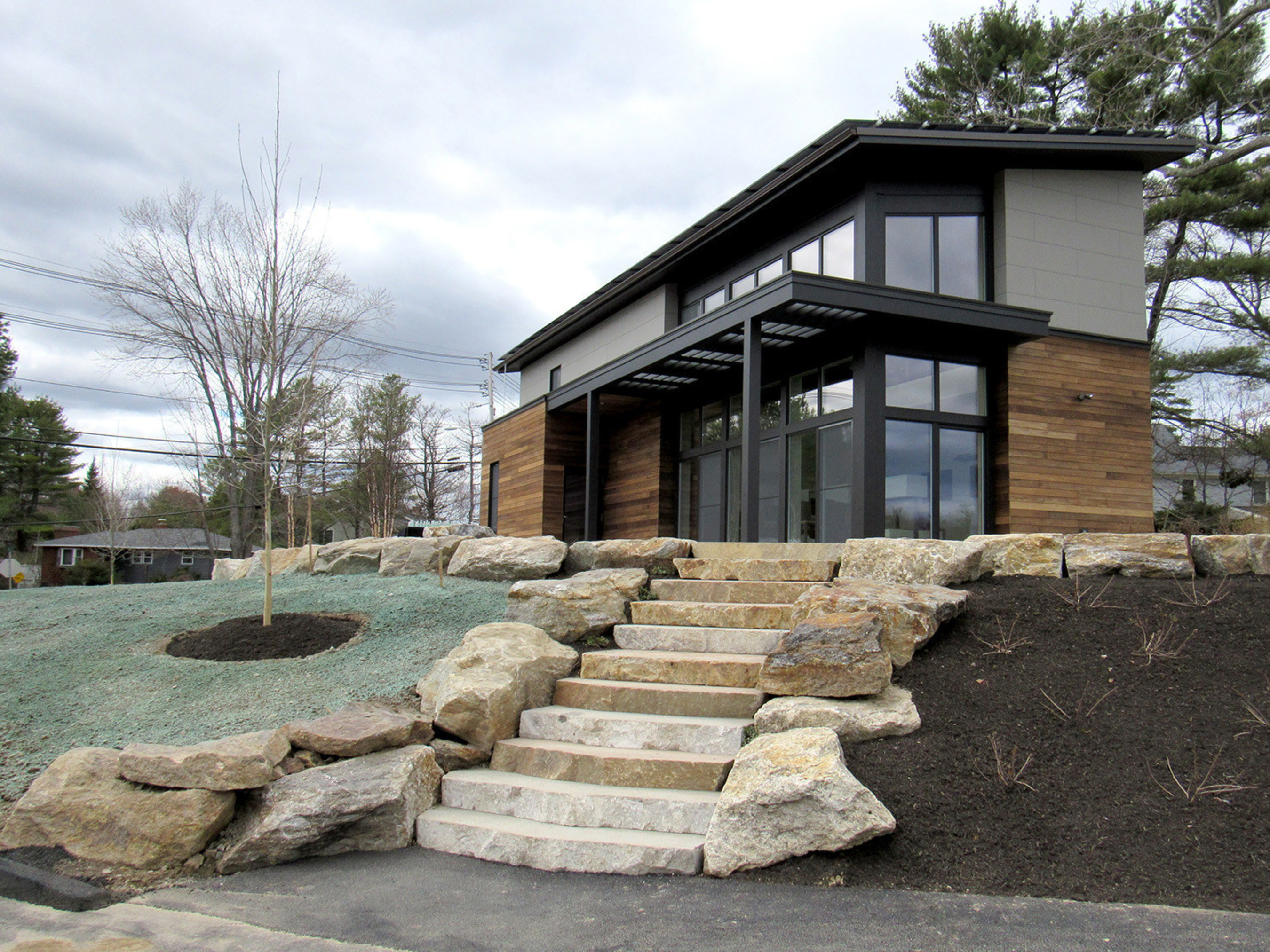 Exterior shot of The Viridescent House, Maine's first net-positive Passive House. Located at TideSmart Global's campus at 380 Route 1 in Falmouth, Maine.