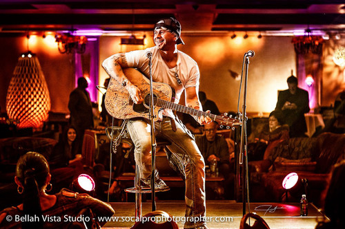 Jared Blake (The Voice) performing on the AVIIR stage to benefit GUARDaHEART. Photo Credit: Jermaine Garcia of Bellah Vista Studio.  (PRNewsFoto/Aviir Inc./Jermaine Garcia of Bellah Vista Studio)