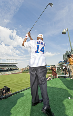 """""""Mr. Cub"""" Ernie Banks tees off from a specially-constructed platform in the stands at Wrigley Field today to mark the start of the 2011 BMW Championship. Banks joined BMW Championship defending champion Dustin Johnson in a historic challenge in which the pair attempted to make a hole-in-one in order to earn a $100,000 college scholarship for the Evans Scholars Foundation, a Chicago-based charity. (PRNewsFoto/BMW Championship, Timothy Hiatt)"""