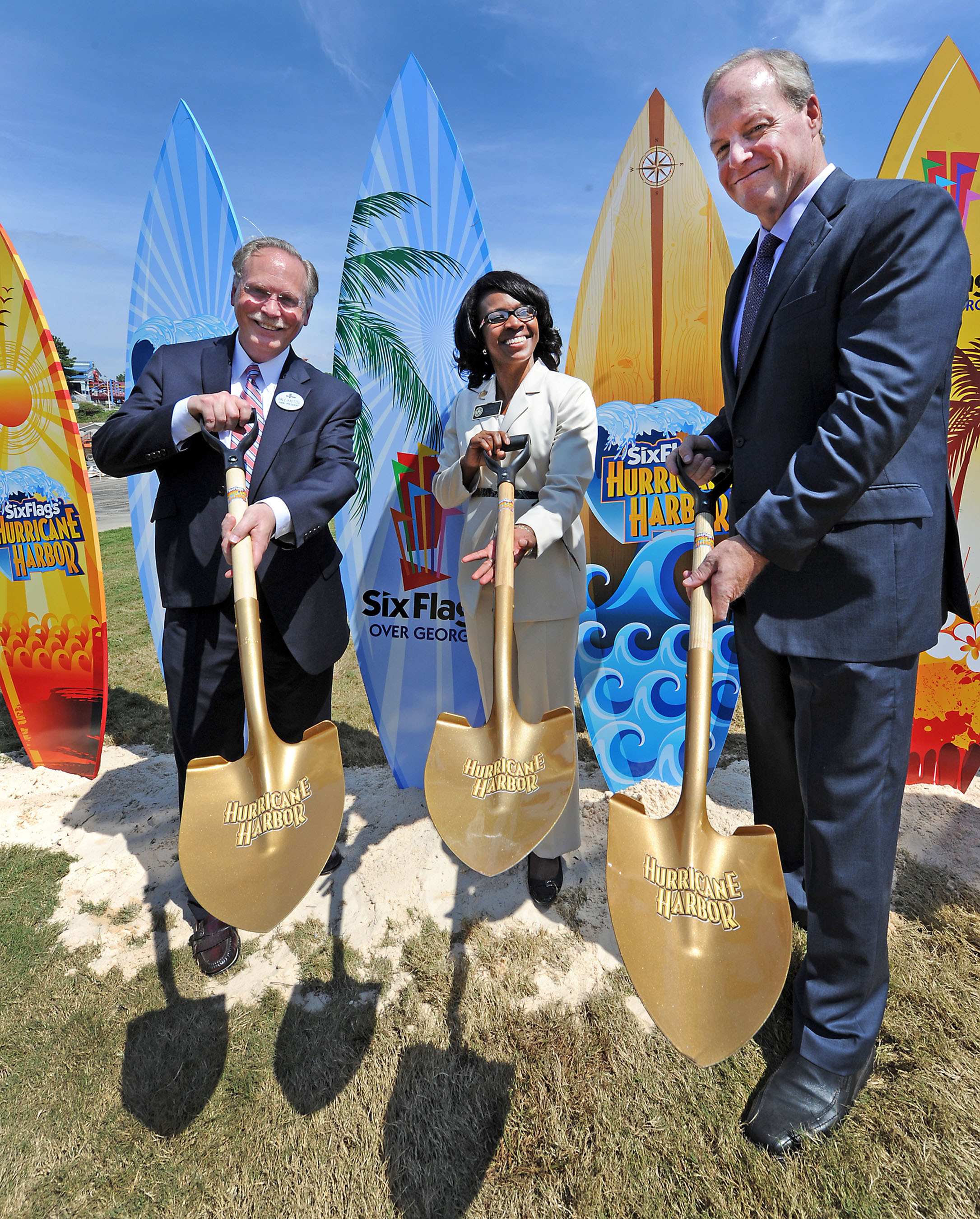 Dale Kaetzel (Left) Six Flags Over Georgia, Park President along with Lisa Cupid (Center) Cobb County Commissioner and John Odum (Right) Senior Vice President Six Flags Park Operations, East Coast, celebrate the ground breaking of Six Flags Over Georgia's Hurricane Harbor due to open in May 2014. The ceremony was symbolically held in conjunction with South Cobb Redevelopment Conference. Six Flags Over Georgia recorded an economic impact of $175 million for its 2012 season. Hurricane Harbor is the largest capital investment from Six Flags Entertainment Corporation for 2014. (HO -- Photo: Michael Pugh). (PRNewsFoto/Six Flags Over Georgia, Michael Pugh) (PRNewsFoto/SIX FLAGS OVER GEORGIA)
