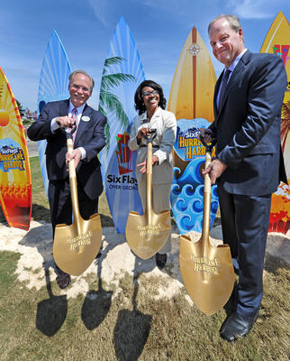 Dale Kaetzel (Left) Six Flags Over Georgia, Park President along with Lisa Cupid (Center) Cobb County Commissioner and John Odum (Right) Senior Vice President Six Flags Park Operations, East Coast, celebrate the ground breaking of Six Flags Over Georgia's Hurricane Harbor due to open in May 2014. The ceremony was symbolically held in conjunction with South Cobb Redevelopment Conference. Six Flags Over Georgia recorded an economic impact of $175 million for its 2012 season. Hurricane Harbor is the largest capital investment from Six Flags Entertainment Corporation for 2014. (HO -- Photo: Michael Pugh).  (PRNewsFoto/Six Flags Over Georgia, Michael Pugh)
