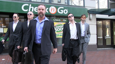 """This scene from """"Less Miserable"""" -- a viral video parody of the Oscar(R)-nominated film """"Les Miserables"""" -- depicts ruthless payday lenders in an innovative social media campaign to identify and educate online Check 'n Go borrowers who may be entitled to significant refunds for interest, fees and finance charges.  The San Francisco City Attorney's Office is running the refund program as part of its litigation settlement with the payday lender.  The deadline for eligible borrowers to file refund claims is March 28, 2013.  (PRNewsFoto/San Francisco City Attorney Dennis Herrera)"""