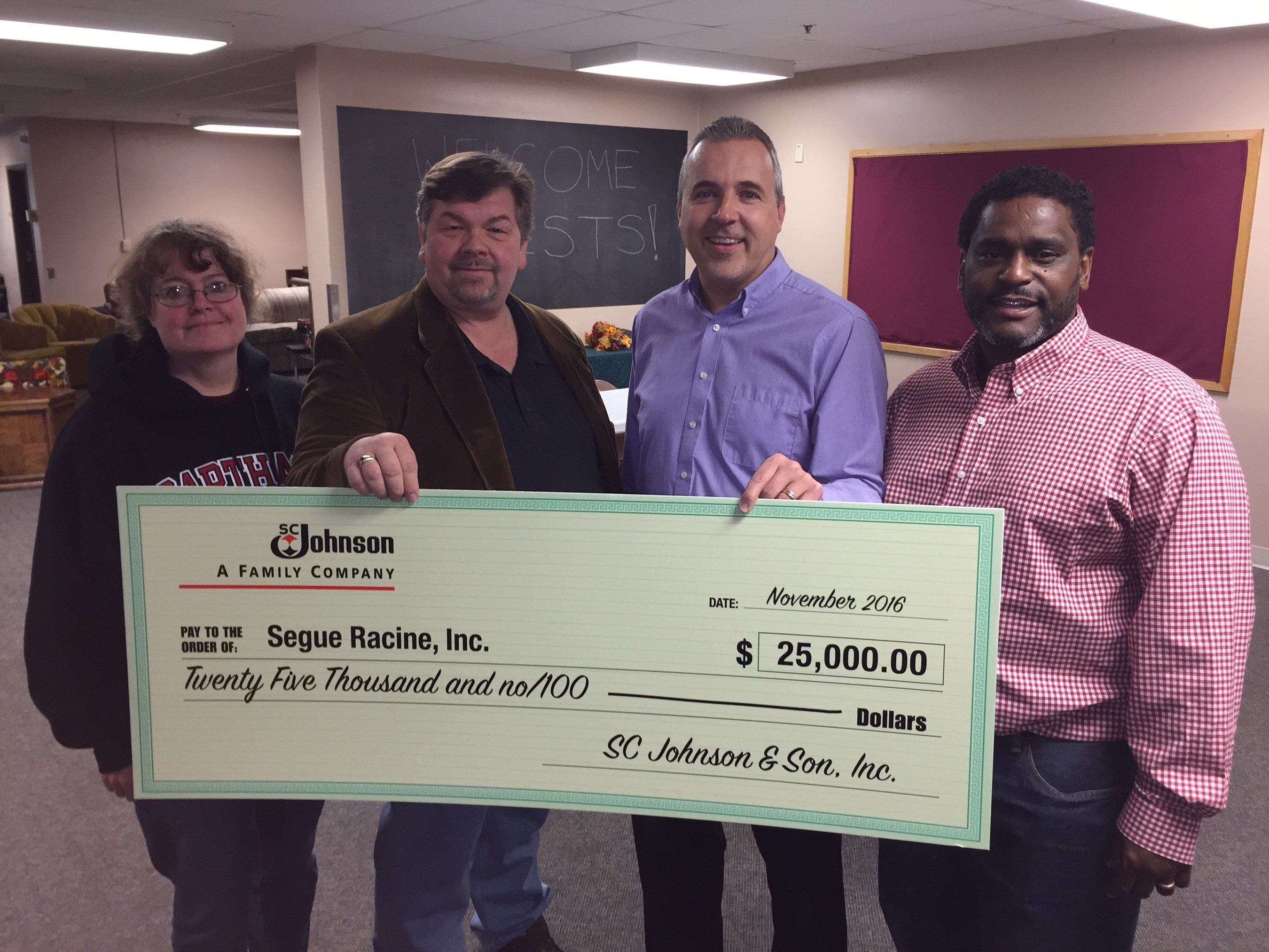 Segue Racine volunteers at check presentation. Left to right: Holly Anderle, Warren Williams, Jim Ladwig-Director of Community Affairs at SC Johnson and Yusuf Buckley. Photo courtesy SC Johnson