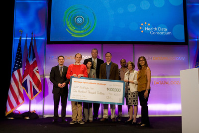 Team Mood Rhythm accepts prize check from Heritage Provider Network.  (PRNewsFoto/Heritage Provider Network, Inc., Blink Photo)