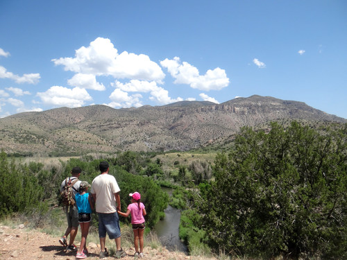A young Latino family overlooks the Gila River in New Mexico during a Hispanic Access Foundation outing. (PRNewsFoto/Hispanic Access Foundation)