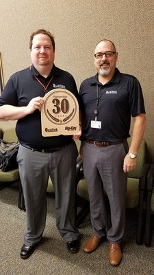 Marc Kaluza (left) and Todd Jesme (Right) of Digi-Key with Qualtek's 30-Year Partnership Plaque