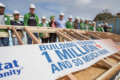 Habitat for Humanity's global leaders and supporters gathered in Atlanta today to raise the wall on Habitat's 800,000th home.  (PRNewsFoto/Habitat for Humanity International)