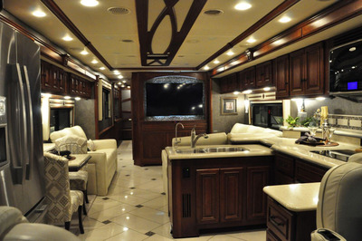 The luxurious new Winnebago Tour 42GD features a spacious interior, high line features and even includes a mid-coach 55-inch LCD HDTV and exclusive HDMI 4 x 4 Matrix system that allows customers to watch high definition video from multiple sources at multiple TVs.  (PRNewsFoto/Winnebago Industries, Inc.)