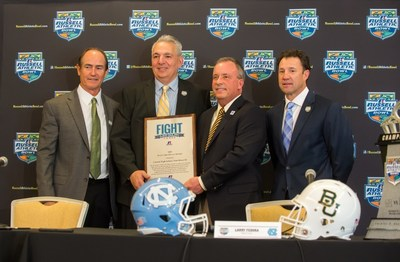 The 2015 Russell Athletic 'Fight Like Dylan Award' is presented to Central High School, Providence, R.I. during the 2015 Russell Athletic Bowl Press Conference; L-R, Baylor University head coach Art Briles; Central High School football coach Peter Rios; Russell Athletic senior vice president, general manager Robby Davis; University of North Carolina head coach Larry Fedora