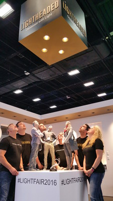 While celebrating their Best Booth award at LIGHTFAIR 2016, the crew at Lightheaded looks up to appreciate the lighting fixtures: an action that every lighting professional recognizes.