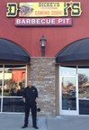 Andre May outside his new Dickey's Barbecue Pit in Highland. May celebrates with three day grand opening barbecue party.