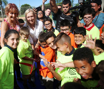 Nancy Lieberman (back left) and Martina Navratilova (back second from left) cut the ribbon on the new multi-purpose Dream Court for members of the Boys & Girls Clubs Miami-Dade Kendall Unit; in partnership with WorldVentures Foundation and Sport Court.