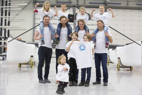 """Back: Tilde Utbult, Carl Svensson, Anthon Sandell Thelma SvenssonFront: Robert Skarp, Carl-Johan Uckelstam, Adam Bergin, Johnie Berntsson (skipper)Meya Vallberg very front pointing to FLUX logo on her sleeve!Carl holding plaque awarded to the FLUXteam by CEO of Aston Harald, Hakan Svensson, at the Ason Harald HQ Hono, Gothenburg, on the unveiling of the FLUXteam M32 catamaran from the factory yesterday Feb 10 - first boat out of the factory for the upcoming M32 Scandinavian SeriesLaunching of the """"Getting Kids On Board"""" initiative. ) (PRNewsFoto/Flux) (PRNewsFoto/Flux)"""