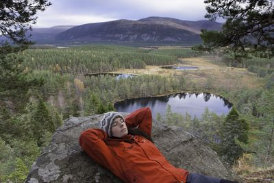 Rebecca Morris, Outdoor Guide and Highland Ambassador of the Year enjoying her favourite natural playground, Uath Lochans, also known locally as the Bear's Paws, in the Cairngorms National Park, Scotland