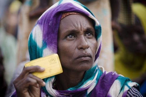 UNHCR / Somalia / UNHCR airlift / Internally displaced women queue with their registration cards for ...