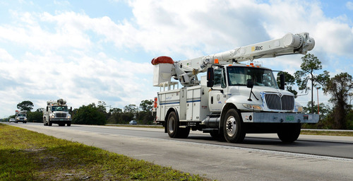 Florida Power & Light Company crews from Miami head north on I-95 to assist Georgia Power for Winter Storm Pax, in Vero Beach, Fla. on Feb. 11, 2014. Photo by Doug Murray/FPL.  (PRNewsFoto/Florida Power & Light Company)