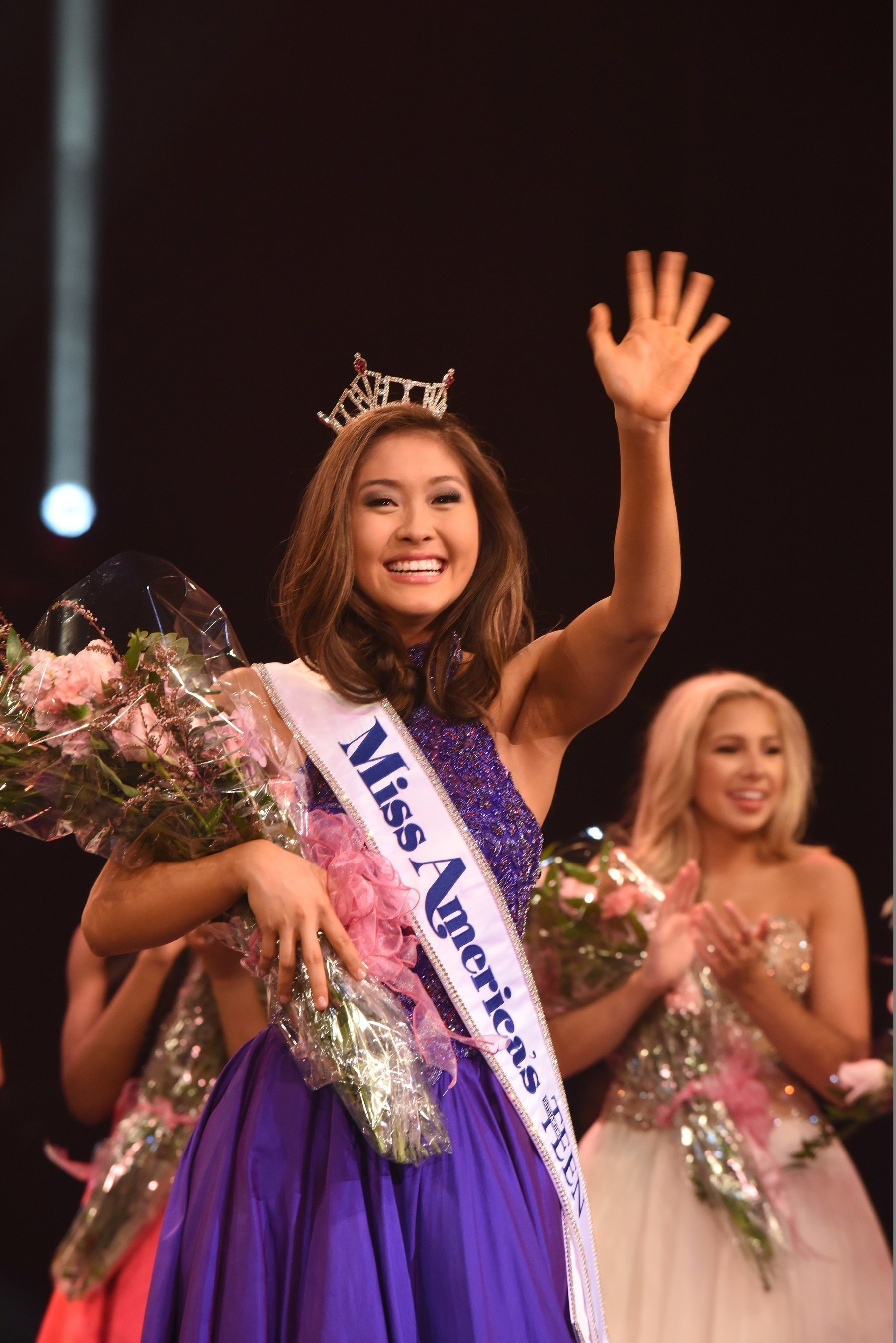 Miss America's Outstanding Teen 2017 Nicole Jia takes her first walk and waves to the crowd after being crowned at the Linda Chapin Theater inside the Orange County Convention Center in Orlando. www.maoteen.org