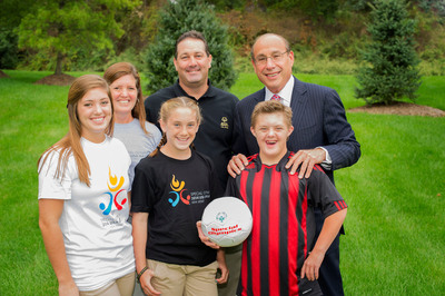 "The McAuliffe family of Cranford, NJ with Barry H. Ostrowsky of Barnabas Health, Proud Sponsor of the 2014 Special Olympics USA Games. The heart of ""Team McAuliffe"" is fourteen-year-old Special Olympics athlete Brian (front row, striped shirt), who competes in soccer, basketball, swimming, and track.  (PRNewsFoto/2014 Special Olympics USA Games)"