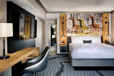 """Oakland Marriott City Center has just unveiled 500 newly designed guest rooms and suites after a $22 million renovation. The design of the new spaces is described as """"industrial powerhouse meets urban graffiti in one of the most culturally diverse cities on the West Coast."""" For information or to make a reservation at the best guaranteed rate, visit www.marriott.com/OAKDT or call 1-510-451-4000."""