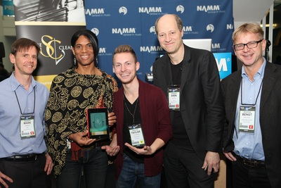 Jazz guitar legend Stanley Jordan and America's Got Talent finalist Taylor Mathews celebrate the U.S. release of ScoreCleaner at NAMM 2013. Left to right: Mark Hiskey, president of ILIO, Stanley Jordan, Taylor Mathews, Sven Ahlback and Bengt Lidgard, founders and creators of ScoreCleaner.  (PRNewsFoto/Score Cleaner)