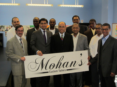 HOPE Program receives custom suit donation from Mohan's Custom Tailors.  (PRNewsFoto/Mohan's Custom Tailors)