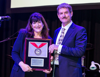 During the recently held World Small Animal Veterinary Association Conference, Lonnie Shoff, President and Chief Executive Officer, Global Animal Health and Strategic Partnerships for Henry Schein, Inc., presented the inaugural Henry Schein Cares International Veterinary Community Service Award to Dr. Ross Trevor Blanks for his exceptional work as a management coordinator for the veterinary emergency response team and a member of the management team that established the animal welfare response center in the aftermath of the catastrophic February 2011 earthquake in Christchurch, New Zealand.  (PRNewsFoto/Henry Schein, Inc.)