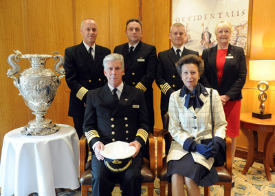 HRH Princess Anne, patron of the National Museum of the Royal Navy (NMRN), takes a photo with Queen Mary 2 Captain Kevin Oprey, front left, and the ship's Hotel Manager Robert Howie, Chief Engineer Brian Harrison, Deputy Captain Stephen J. Howarth and Human Resources Manager Valerie Contreras, back left to right. (Photo by Diane Bondareff/AP Images for Cunard)