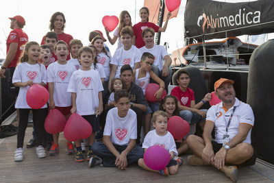 USA's Team Alvimedica sails around world for heart health - It's American Heart Month and the USA entry in the Volvo Ocean Race today announced a World Heart Health Charity Tour to benefit 10 heart charities at the 10 race ports around the world. The USA stop is in Newport, RI, May 5-17.  Spain's national children's heart charity recipients, here with Alvimedica CEO Dr. Cem Bozkurt (right), were first to benefit from this global initiative. Image by Gilles Martin-Raget.