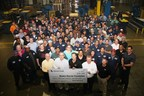 """Employees at Meritor's Plainfield, Illinois site present a check for $30,000 raised in the """"Shoes for Soldiers"""" campaign, which earmarked a percentage of its remanufactured brake shoe sales to the Wyakin Warrior Foundation. The Meritor Trust Fund added $20,000 in support of the foundation, which helps severely wounded veterans achieve professional and personal success."""