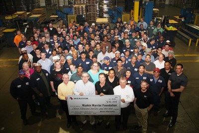 "Employees at Meritor's Plainfield, Illinois site present a check for $30,000 raised in the ""Shoes for Soldiers"" campaign, which earmarked a percentage of its remanufactured brake shoe sales to the Wyakin Warrior Foundation. The Meritor Trust Fund added $20,000 in support of the foundation, which helps severely wounded veterans achieve professional and personal success."