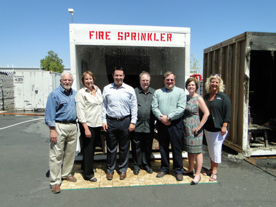 HFSC Board Members, including NFSA Director of Outreach & Government Relations, Vickie Pritchett (far right) join Ron Hazelton (far left) following the side by side burn demonstration. The fire sprinkler activated in 45 seconds in the sprinklered room, while flashover occurred in the non-sprinklered room in 1 1/2 minute!