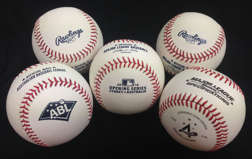 Rawlings baseballs dominate Australian baseball (foreground, from left to right): the Official Baseball of the ...