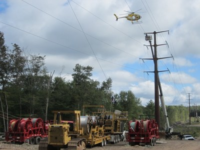 A helicopter helps string new wires over a portion of the Northeast-Pocono Reliability Project.