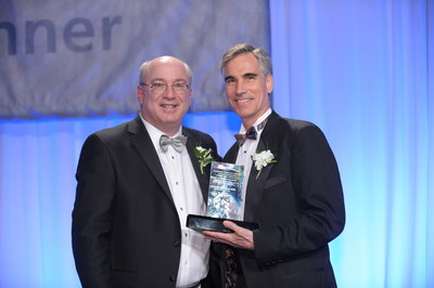 Pictured accepting the Spencer Foreman Award from Peter L. Slavin, MD, AAMC chair, is Joseph St. Geme, MD, physician-in-chief and chairman of the Department of Pediatrics at The Children's Hospital of Philadelphia