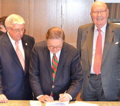 From left to right -- Mayor Swails, W. Clay Hamner and Mr. Way, visited together in Chapel Hill Thursday to finalize and sign the agreement to bring Southern Season to Mt. Pleasant.  (PRNewsFoto/Southern Season)