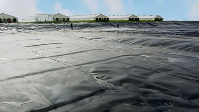 A lagoon cover installed at a hog production facility at Murphy Brown Missouri is part of an $80 million renewable energy project with Roeslein Alternative Energy LLC. The project is the largest of its kind that will utilize manure from one of the biggest concentrations of finishing hogs in the Midwest. The project will demonstrate how underutilized agricultural resources can create Renewable Natural Gas, benefit the ecosystem and generate economic opportunity. (PRNewsFoto/Roeslein Alternative Energy, LLC)