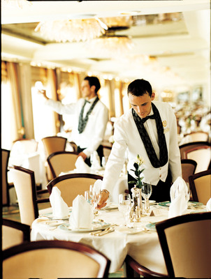 Waiters prepare tables for dining in the Crystal Dining Room.