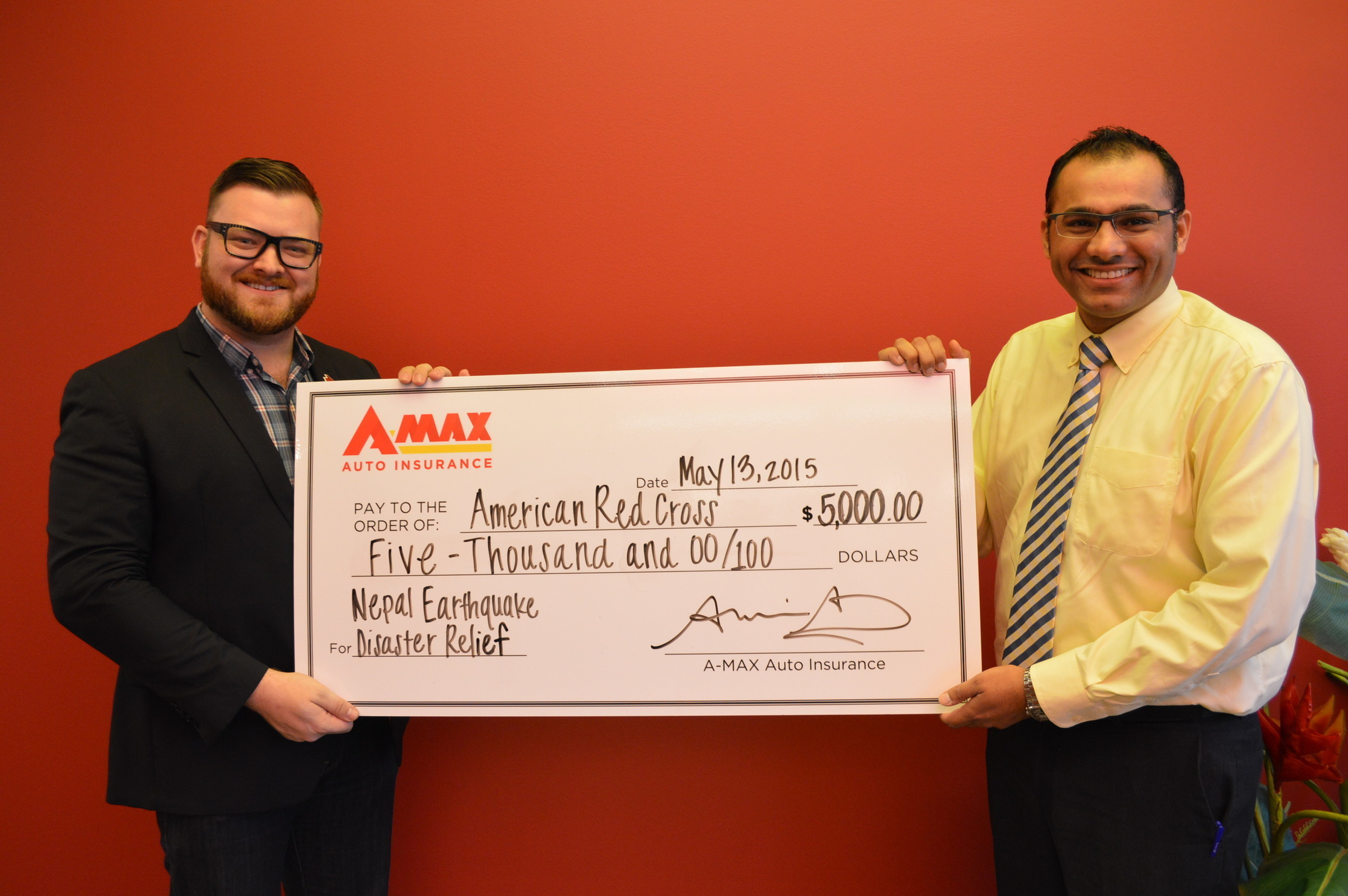 Nash Hariyani (right), development manager at A-MAX Auto Insurance, presents a $5,000 donation to Zach Hess (left), corporate partnerships officer at American Red Cross North Texas Region.