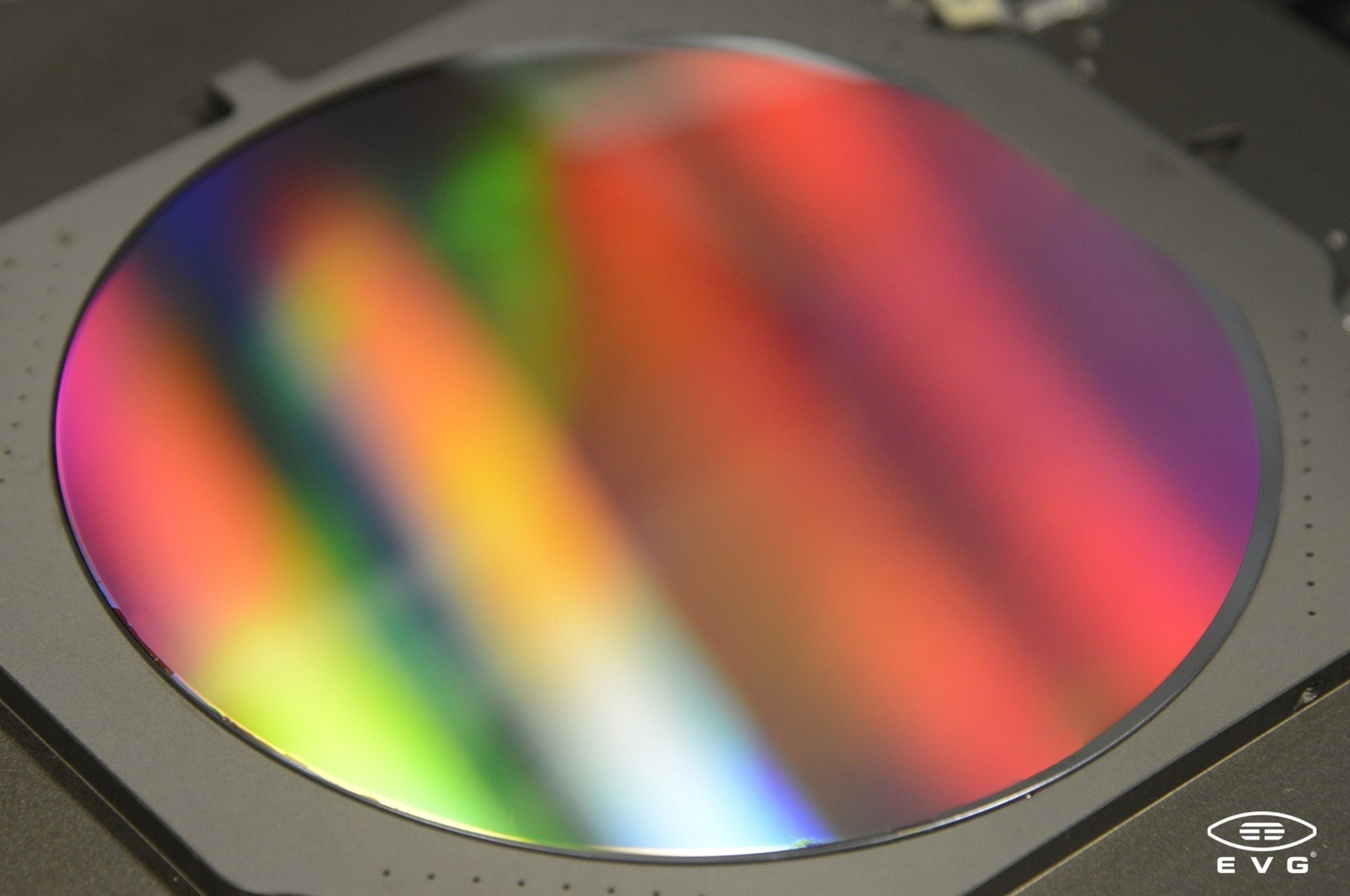 EV Group's NILPhotonics(TM) Competence Center assists customers in leveraging EVG's nanoimprint lithography (NIL) solutions to enable new photonic products and applications. Shown here is a six-inch full-area nanoimprinted wafer processed by EVG NIL solutions. This technology enables almost infinite design freedom to create various kinds of photonic structures.