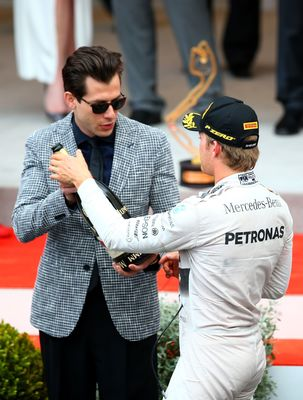 World renowned music artist Mark Ronson awarded the winning Jeroboam of Mumm Cordon Rouge to Nico Rosberg on the podium of the 2015 Monaco Grand Prix. Ronson was chosen for the honour as a friend of Maison Mumm; the previous night Ronson hosted a VIP party on board Mummâeuro(TM)s private Yacht to launch a new innovation by the House - the worldâeuro(TM)s first connected champagne bottle. (PRNewsFoto/Maison Mumm)