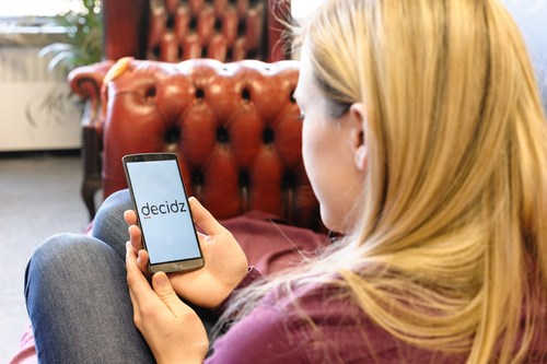 Girl using Decidz, the Free Social Media app. (PRNewsFoto/Decidz)