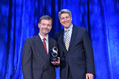 PurThread VP of Infection Control Applications Bill O'Neill collects the 2013 American Technology Award for Advanced Manufacturing from TechAmerica CEO Shawn Osborne.  (PRNewsFoto/PurThread Technologies, Inc.)