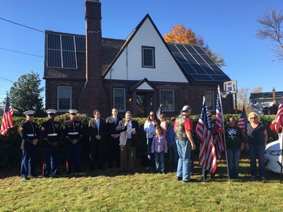 Caption: Dedication ceremony of the SUNation Cares donated solar system(from left to right: Marine Honor Guard, Senator Todd Kaminsky, CongressmanLee Zeldin, SUNation CEO Scott Maskin, Eileen Howell and family, PatriotGuard Riders)