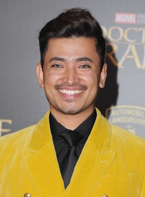 Pritan Ambroase flashes a million dollar smile on the red carpet at the world premiere of Doctor Strange. Ambroase is wearing Jeffery Rudes.