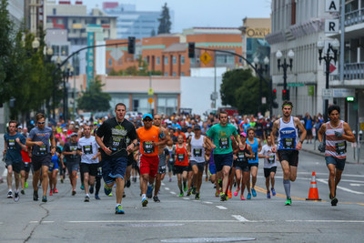 "Runners race through Oakland in the inaugural ""The Town's Half Marathon Filtered by Brita"""