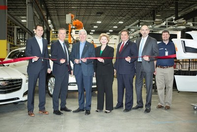 Magna International Inc. announced today the grand opening of DexSys, a new greenfield facility in Delta Township, Michigan, for the manufacture of automotive exterior products. Company officials were joined by Michigan Governor Rick Snyder, United States Senator Debbie Stabenow, members of local government, and executives from General Motors to celebrate the occasion. (PRNewsFoto/Magna International Inc.)