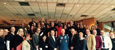 The Futuri Media team at a recent company meeting with Astronaut Rick Searfoss.