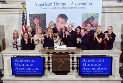 The American Humane Association (AHA), the nation's voice for the protection of children and animals for 134 years, led by President and CEO Robin R. Ganzert in the company of AHA National Spokesdog Rin Tin Tin, visit the New York Stock Exchange and ring The Closing Bell in honor of the hero dogs at Ground Zero on September 11, 2011.  More than 300 heroic dogs assisted with the search for survivors and victims of the World Trade Center tragedy, while therapy dogs provided emotional support to rescue workers and families of victims. In the days following September 11th, the AHA brought its 82-foot mobile veterinary clinic and rescue rig to NYC as well as its Red Star(TM) Animal Emergency Services teams to coordinate food and fresh water to search and rescue dogs. AHA provided some of the harnesses and leashes that handler teams needed and gave on-site training on how to use the harnesses. Additionally, AHA set up a treatment center for injured and exhausted search and rescue dogs on the Staten Island Landfill site where dogs were decontaminated of toxins after each shift.  (PRNewsFoto/American Humane Association, NYSE Euronext/Valerie Caviness)