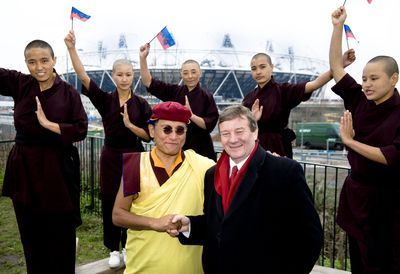 His Holiness the Gyalwang Drukpa blessing the forthcoming Olympic Games in London. As part of an international trip to raise awareness for his humanitarian work, His Holiness the Gyalwang Drukpa received an official welcome to the View Tube and Olympic Park, Stratford, London. Olympic Legacy Park Company board member Lord Mawson is pictured with His Holiness and the Kung Fu nuns at the view Tube during the tour of the Olympic Park.